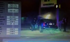 Ill. police rescue 2 from burning car
